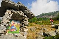 Wayside shrine, hiker in background, Alpe Corte Nuovo, Valle Bavona, Ticino range, Ticino, Switzerland