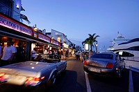 Luxury cars, Restaurants near harbour, Puerto Banus, Marbella, Andalusia, Spain