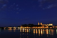 View over river Rhone to the bridge, city walls, cathedral Notre_Dame_des_Doms and papal palace at night, Avignon, Vaucluse, Provence, France, Europe