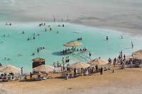 View at people on the beach and in the dead sea, En Bokek, Israel, Middle East