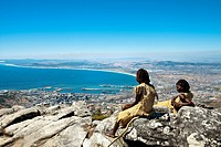 Two African women in traditional clothes on Table Mountain, View towards Cape Town, Western Cape, South Africa, Africa