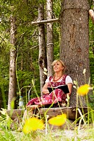 Author Brigitte Weninger writing under a tree, Kaisertal, Ebbs, Tyrol, Austria