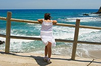 GIRL LOOKING THE SEA, ISLETA DEL MORO, CABO DE GATA NATURAL PARK, ALMERIA, ANDALUCIA, SPAIN