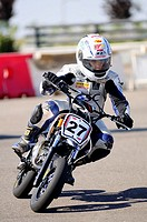 Motorist in a race of mini-motorbikes