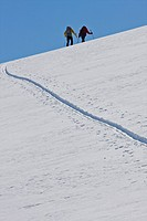 Men backcountry skiing, Parker Ridge, Banff National Park, Alberta, Canada