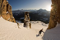 A backcountry skier hiking with ski gear, Bow Peak, Icefields Parkway, Banff National Park, Alberta, Canada