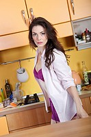 woman with nightshirt in the kitchen