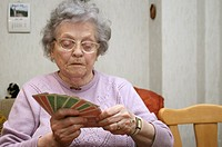 old lady plays at cards