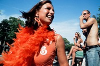 Young Dutch woman partying on a boat during the Gay Pride Canal Parade, Amsterdam, the Netherlands
