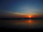 This stock photo is a stunning sunset at the beach as the sun is just about to dip over the horizon Horizontal format this conveys of concepts of vaca...