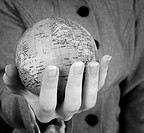 Globe in a girls hands Macro image
