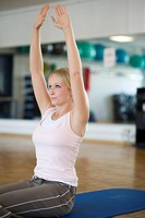 blonde woman trains her abs