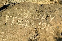 Inscription on rock at Petroglyph National Monument reads, February 22, 1919 demonstrating vandalism of Native American petroglyphs, outside Albuquerq...