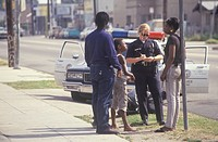 Policewoman taking a report, South Central Los Angeles, California
