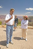 Senator John Kerry, with family, speaking at rim of Bright Angel Lookout, Grand Canyon, AZ