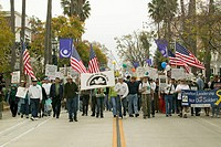 A large crowd of protesters are led by Veterans Against the Iraq War on State Street at an anti_Iraq War protest march in Santa Barbara, California on...