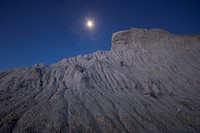 The moon shines over White Butte in early morning.