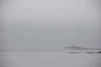 The Seguin Island light house is visible from Popham Beach, Maine.