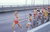 Group of runners crossing Verrazano Bridge at the beginning of the NY Marathon