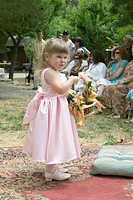 Little girl with basket of flowers at a traditional Jewish wedding in Ojai, CA