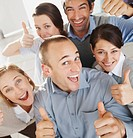 Group of business colleagues showing thumbs up