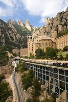The jagged mountains in Catalonia, Spain, showing the Benedictine Abbey at Montserrat, Santa Maria de Montserrat, near Barcelona, where some feel the ...