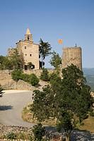Historic castle flying Spanish flag near village of Solsona, Cataluna, Spain