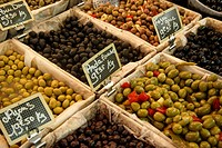 Large olives for sale in Parisian street market.