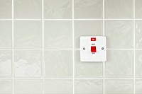 On Off switch with indicator on tiled wall