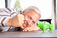Man making a fist towards a green bull