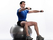 man exercising workout on white background  Seated Swiss Ball Lateral Arm Raise