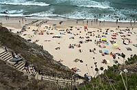 surfers down to the beach. Alentejo, Portugal