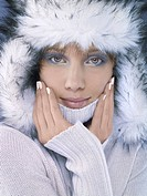 Portrait of young woman in white fur hat, close_up