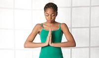 African American teen meditating