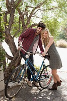 Affectionate young couple on vacation with bicycles