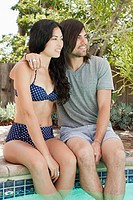 Young couple in swimming pool on vacation