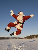 Santa Claus jumping in the snow