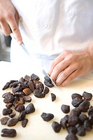 Chef slicing dried figs