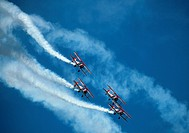 Four bi-planes in formation making an acrobatic dive maneuver at Chicago Air and Water Show