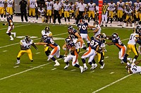 Denver running back Lance Ball breaks through the line, Denver Broncos vs. Pittsburgh Steelers NFL football game, Invesco Field at Mile High (stadium)...