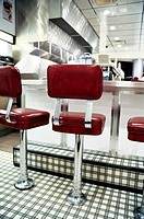 Red Vinyl Stools and Counter of a 1950's Retro Diner