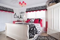White, black and pink teenager bedroom decorated with matching color furniture and furnishing