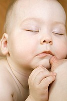 Infant child asleep with nipple