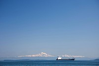 A cargo ship goes through the Gulf Islands.