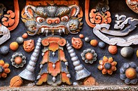 Close_up of a relief in a Buddhist monastery.