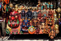 Tibetan masks and other magical souvenirs for sale in a marketplace.