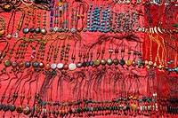 Colorful necklaces for sale on the roadside.