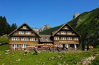 Hikers arriving at the mountain inn Bollenwees, Bruelisau, Alpstein mountain range, canton of Appenzell Innerrhoden, Switzerland