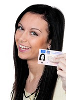 Woman with car keys and driver´s license. Driving test