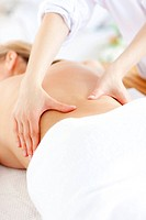 Close_up of a caucasian woman receiving a back massage in a spa center